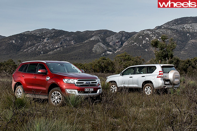 Everest -v -Prado -side -parked -field