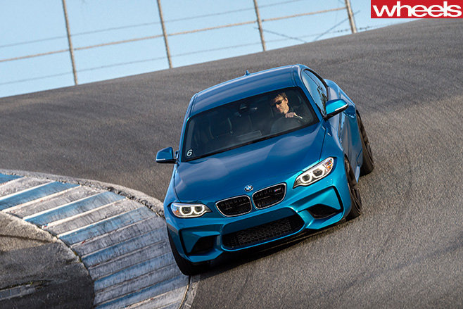 BMW-M2-driving -around -a -track -front