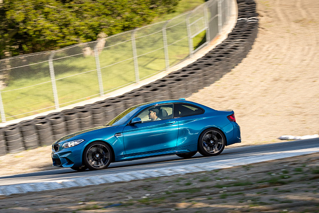 BMW-M2-driven -hard -around -a -track -side