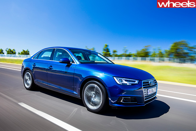 Blue -Audi -A4-driving -front -side