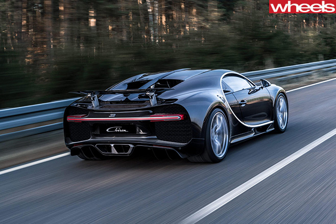 Black -Bugatti -Chiron -driving -rear-