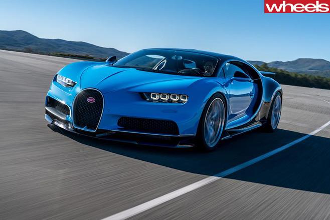 Blue -Bugatti -Chiron -driving -front