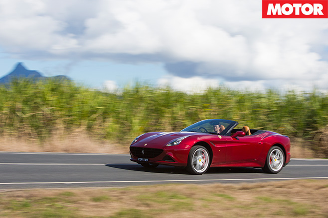 Ferrari -california -t -driving -with -roof -up -8