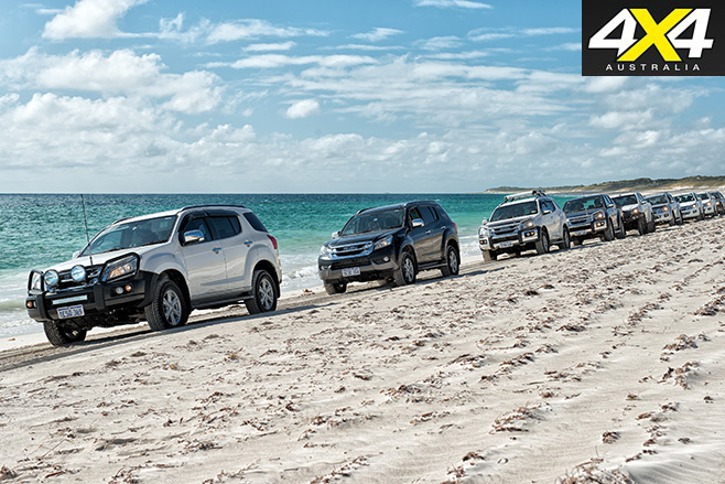 Isuzus lined up on the beach