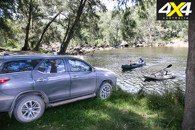 Toyota -parked -next -to -river