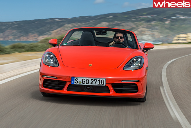 Orange -Porsche -918-Boxster -S-driving -front