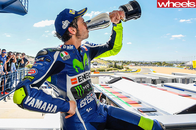 Motogp -Rossi -drinks -from -Cup