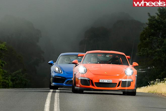 2016-Porsche -911-GT3-RS-v -2016-Porsche -Cayman -GT4-driving -front
