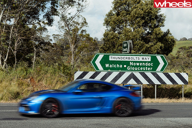 2016-Porsche -Cayman -GT4-side -driving