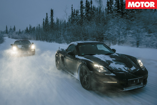 Porsche 718 Boxsters driving in snow