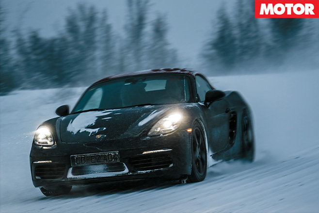 Porsche 718 Boxsters driving front in snow