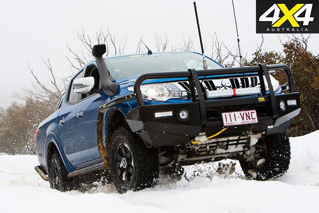 Custom 4x4 TJM Mitsubishi Triton front in snow