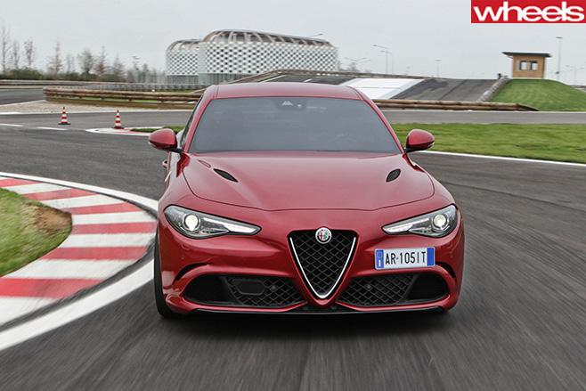 Alfa -Romeo _Quadrofoglio -front -driving -track