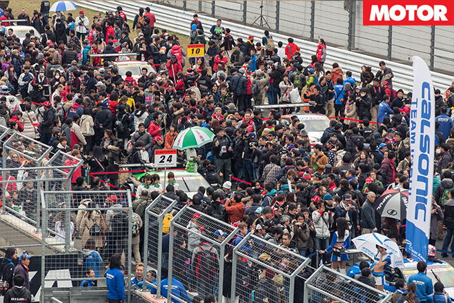Crowds in the pits
