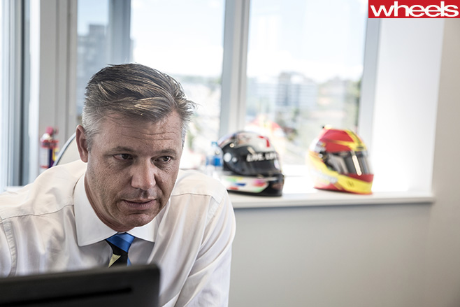 James -Warburton -in -front -of -desk