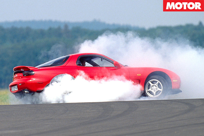 Mazda rx-7 burning rubber