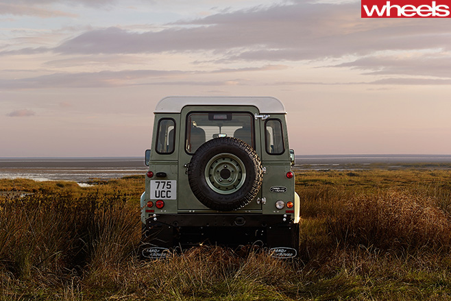 Land -Rover -Defender -driving -rear