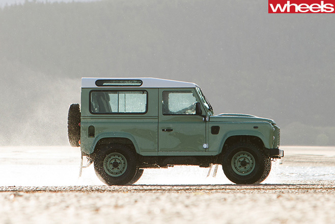 Land -Rover -Defender -driving -side -beach