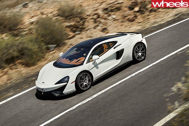 Mc Laren -570GT-top -side -driving -mountain -road