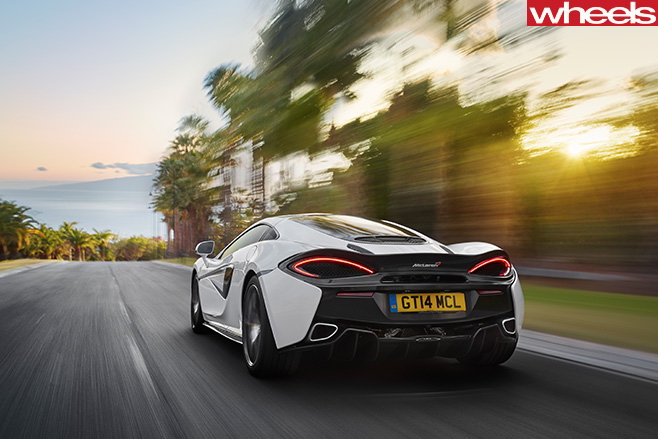Mc Laren -570GT-rear -driving -mountain -road