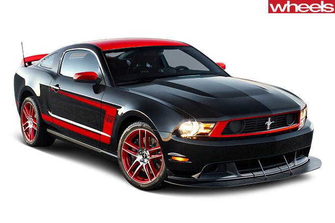 Red -Ford -Mustang -driving -front -side -Boss -302