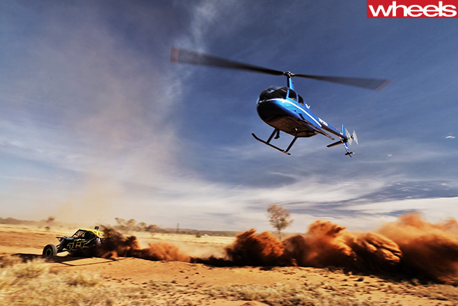 Helicopter -with -Off -road -vehicle -participating -in -Finke -Desert -Race -driving