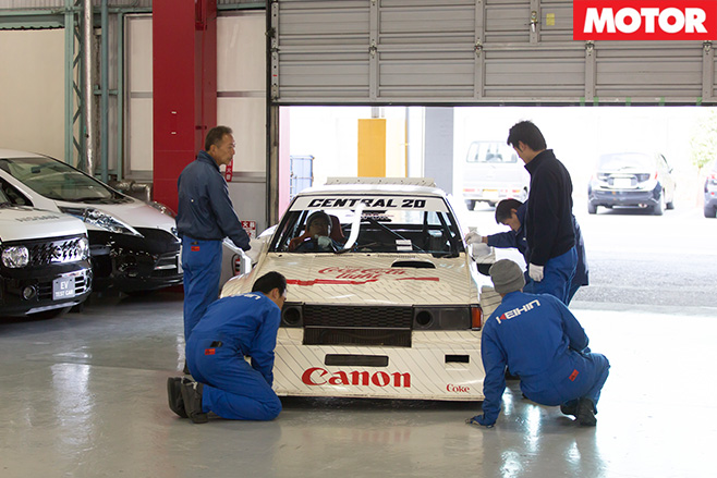 Mechanics work on cars
