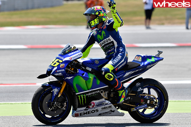 Valentino -Rossi -riding -motorbike -side