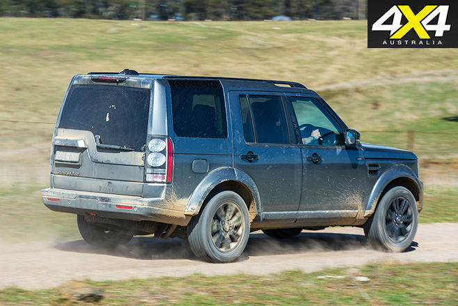 Land rover discovery driving on gravel