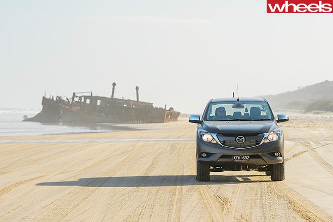 Mazda -BT-50-driving -on -beach -Fraser -Island