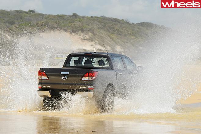 Mazda -BT-50-rear -driving -through -sand -water