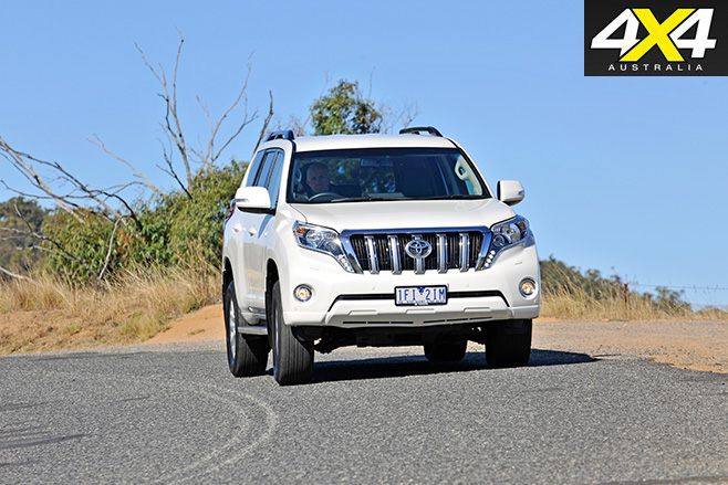 Toyota Prado driving on the road