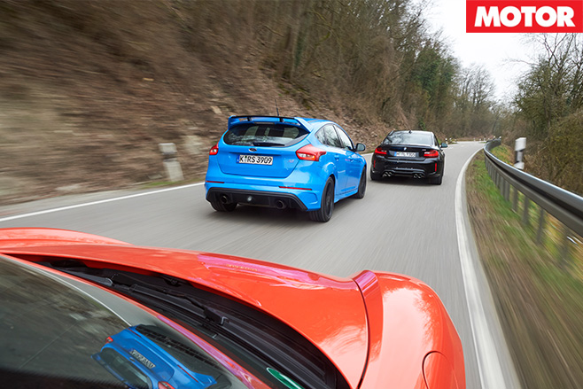 Three cars driving rear