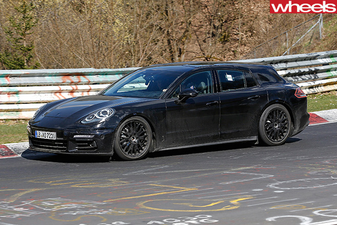 Black -Porsche -Panamera -driving -side