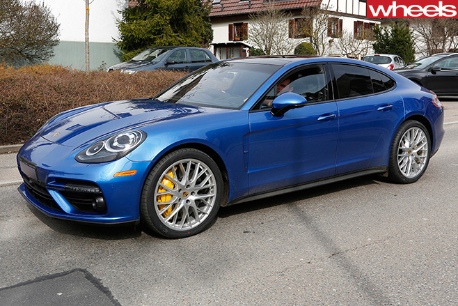 Blue -Porsche -Panamera -driving -on -track