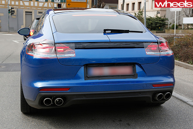Blue -Porsche -Panamera -driving -rear