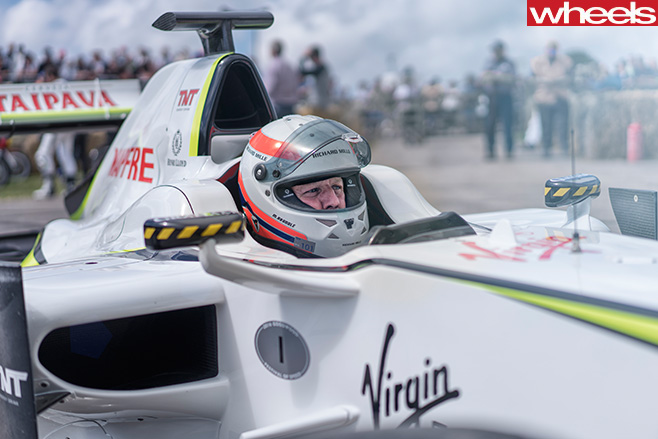 Driver -sitting -in -smokey -F1-Car -Goodwood -festival -of -speed