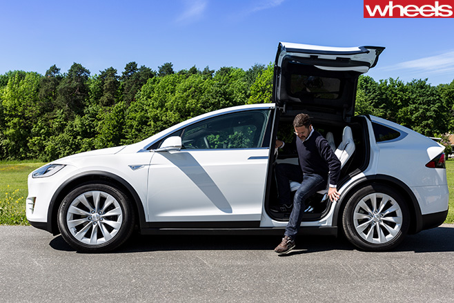 Tesla -Model -X-gull -wing -doors -getting -out
