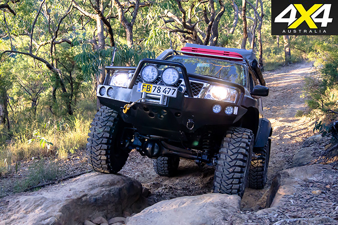 Custom Nissan Patrol GU driving over rocks
