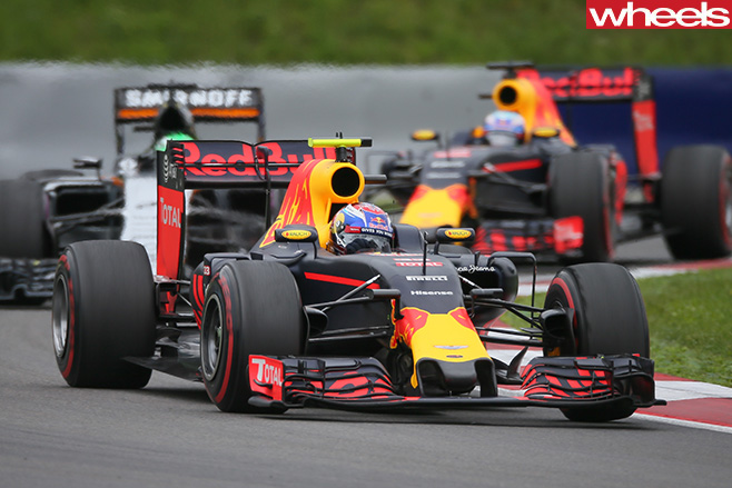 Red -Bull -F1-car -driving -front -side