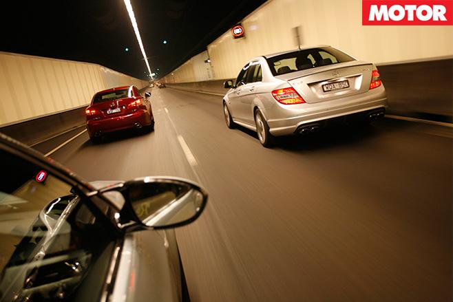 3 cars driving through tunnel