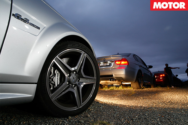 BMW wheels with cars lined up