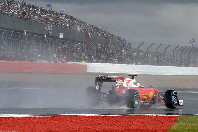 Ferrari drivers Kimi Raikkonen and Sebastian Vettel