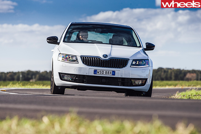 Skoda -Octavia -white -driving -front -on