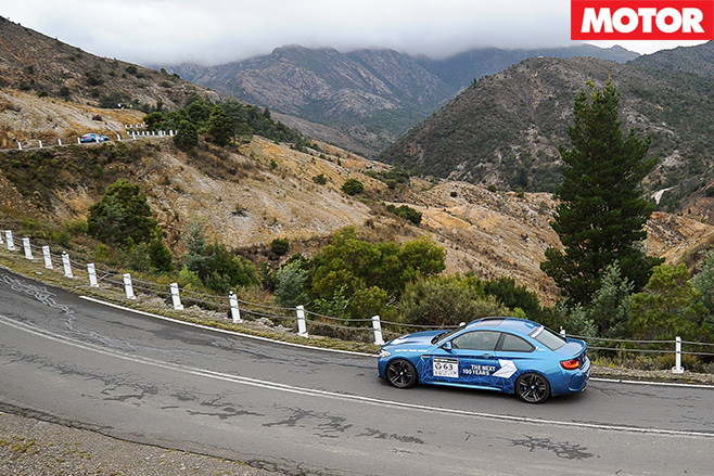 BMW M2 driving along mountains
