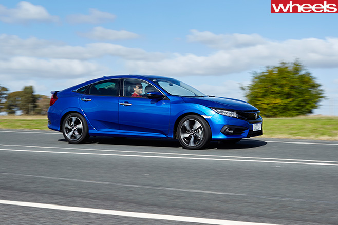 Honda Civic RS test driving side-on