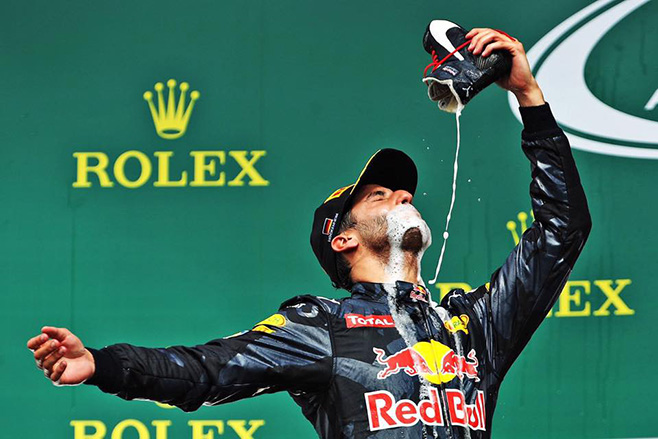 Daniel Ricciardo takes a shoey on the podium at the German Grand Prix