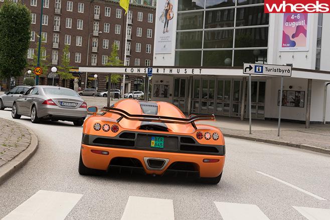 Orange -Koenigsegg -supercar -rear -driving