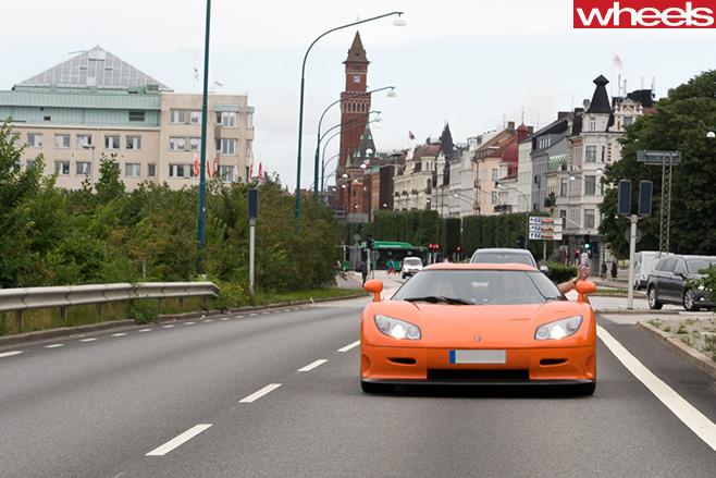 Orange -Koenigsegg -supercar -driving -street