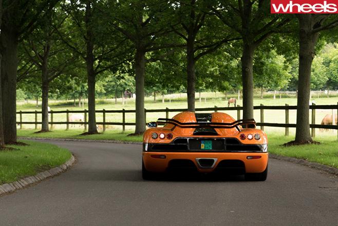 Orange -Koenigsegg -rear -trees